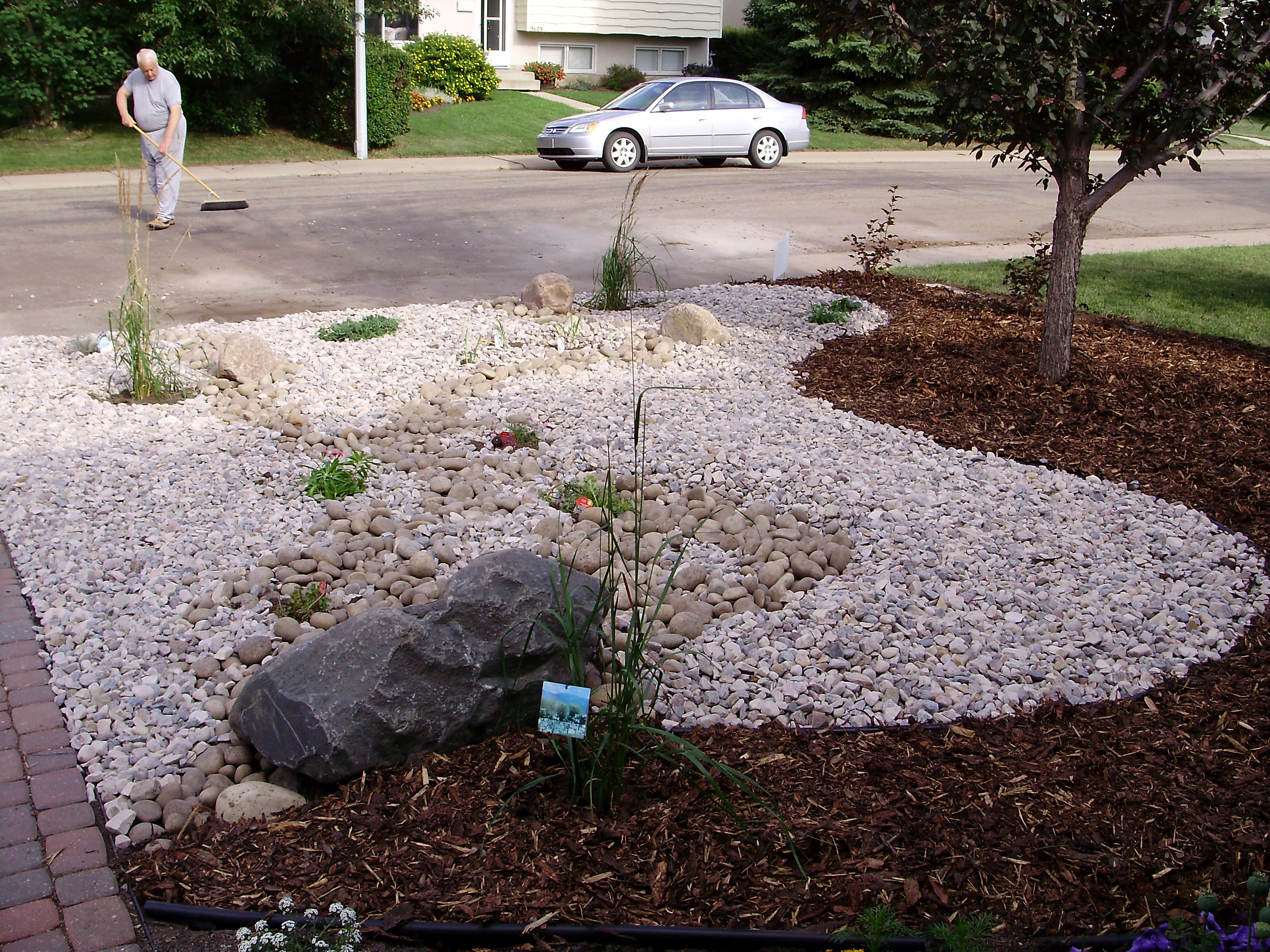 Front yard mature yard renovation xeriscaped whitemud for Xeriscaped backyard design