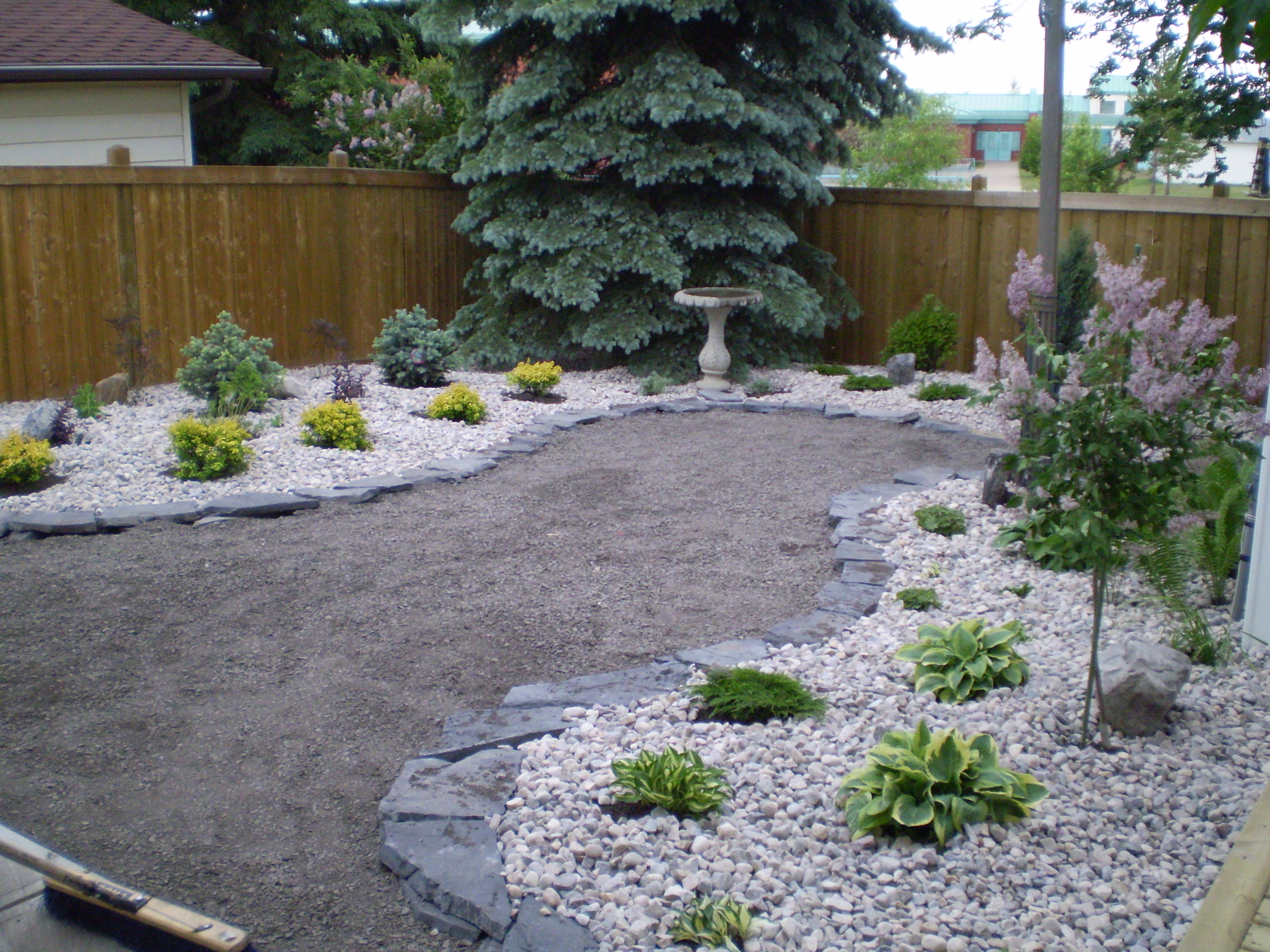 Landscape construction whitemud landscaping and garden for Different backyard ideas
