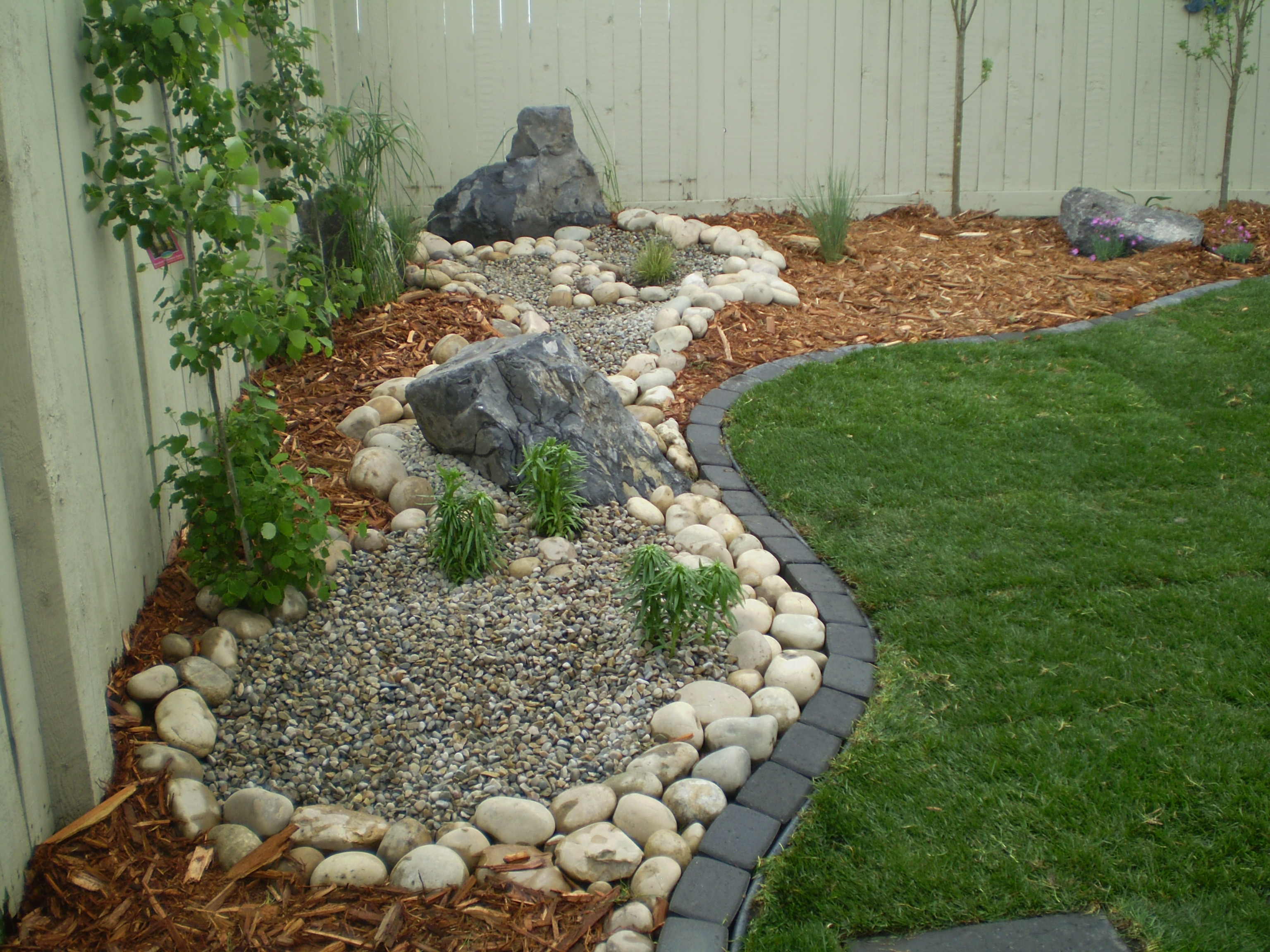 Hyams Landscaping And Garden Center : Back yard reno complete with variety of features
